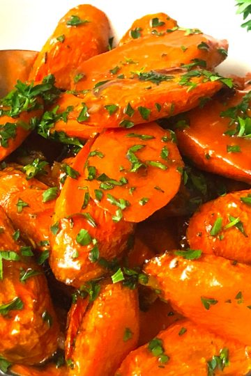 close up of air fried carrots with parsley and brown sugar and butter sauce