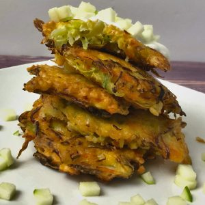stack of the cabbage fritters with honey, greek yogurt, and diced appleso