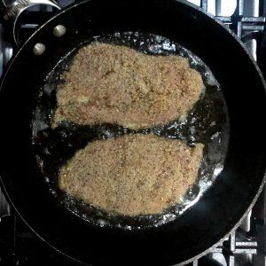 frying up italian chicken cutlets