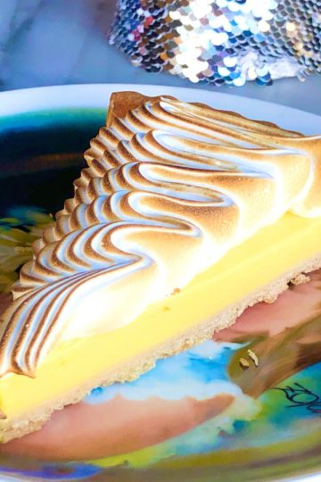 a slice of tarte au citron with burnt italian merengue