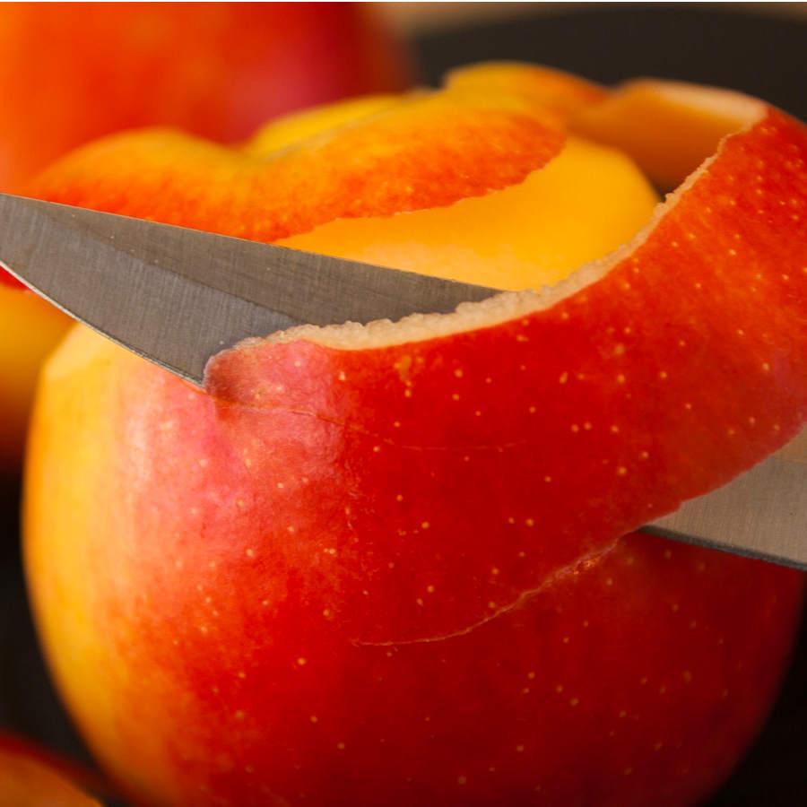peeling an apple with fruit knife