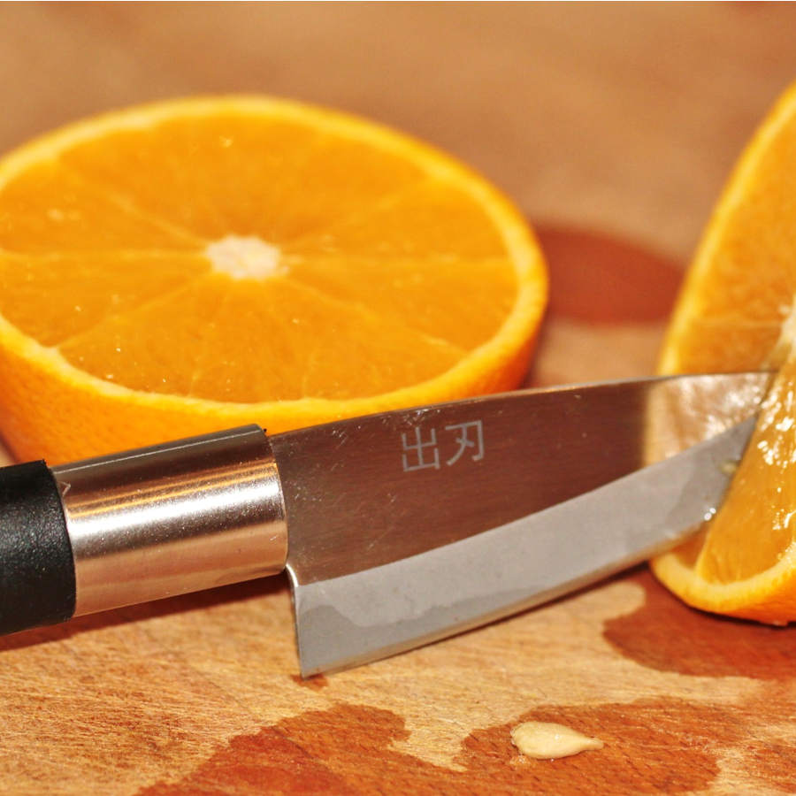 fruit knives cutting orange