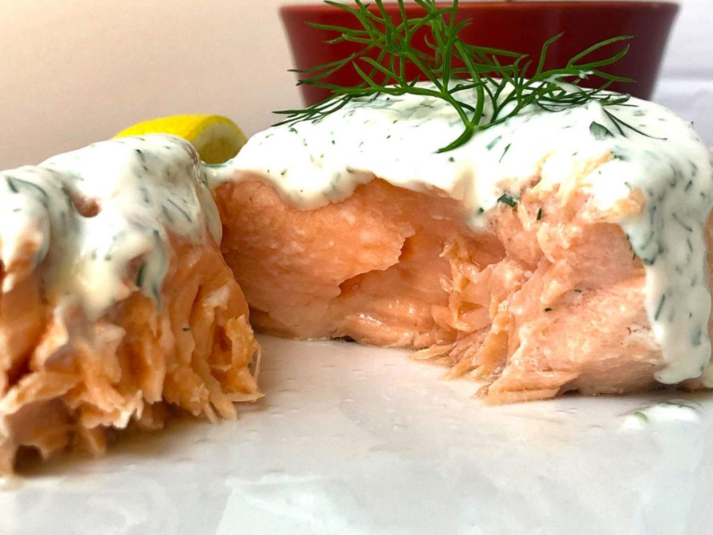 perfectly cooked poached salmon with dill