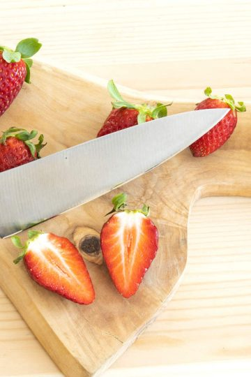 fruit knife cutting strawberries