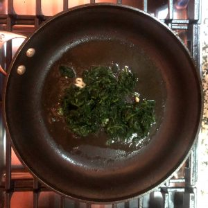 garlic and spinach in saute pan