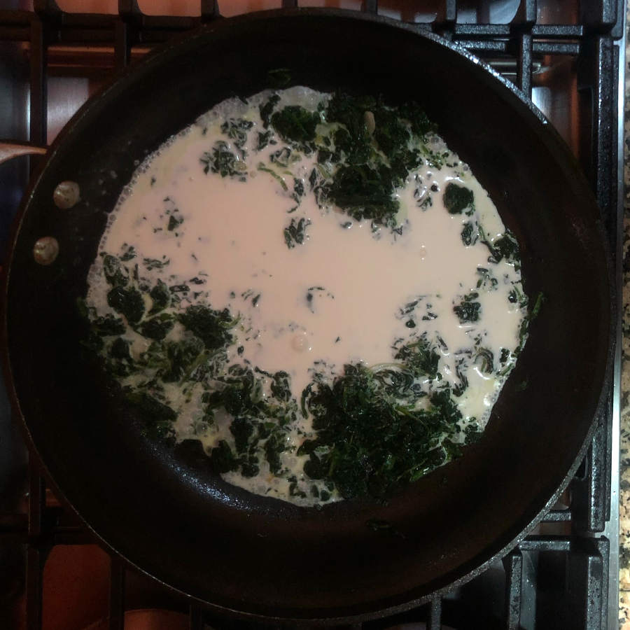 spinach and cream in pan for pasta sauce