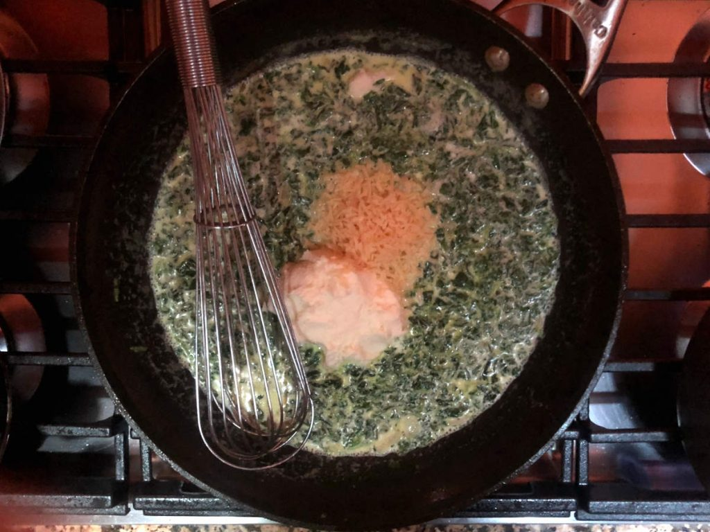 whisk in ricotta and parmesan into spinach cream sauce