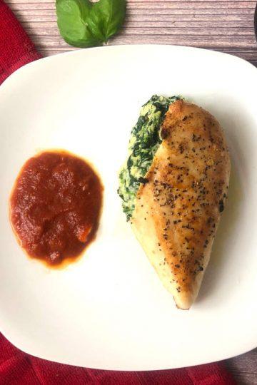 mozzarella and ricotta stuffed chicken with tomato sauce